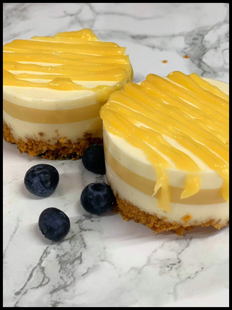 Delicious Fresh Lemon Curd Cheesecakes on Ginger Nut Base